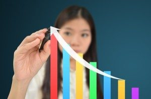 10472390 - business woman drawing a graph showing growth of business